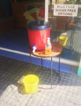 Makeshift hand-washing station outside local ice cream shop in Mexico - Riding the pandemic wave in Mexico
