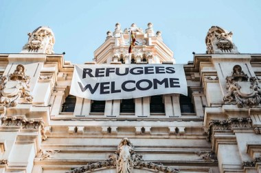 Big sign of Refugees Welcome in a public Madrid building - Alternative Madrid things to do