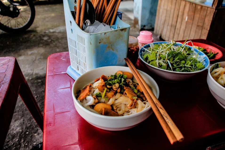 Noodles and small bird eggs in an open air street restaurant in Da Nang - Traditional Vietnamese food