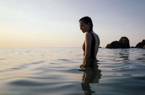 Solo female traveler enjoying a quiet sunset in Ko Pha Ngan, Thailand
