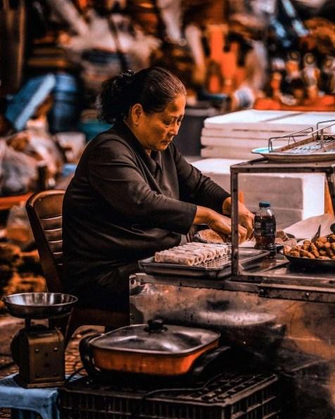Woman working on a stall in the French Quarter, Tràng Tiền, Hoàn Kiếm, Hà Nội, Việt Nam