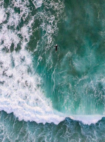 Surfer as seen from above in Sydney NSW, Australia