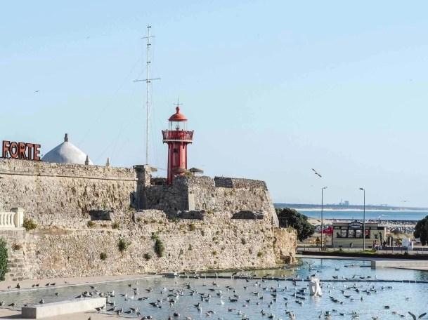 Forte de Santa Caterina and red lighthouse in Figueira da Foz