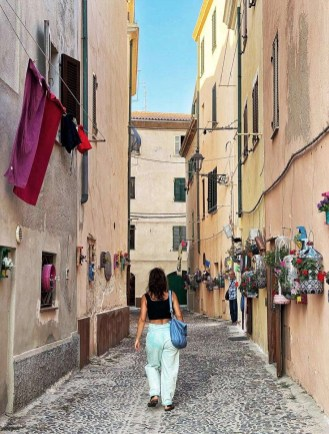 Girl strolling around Alghero streets