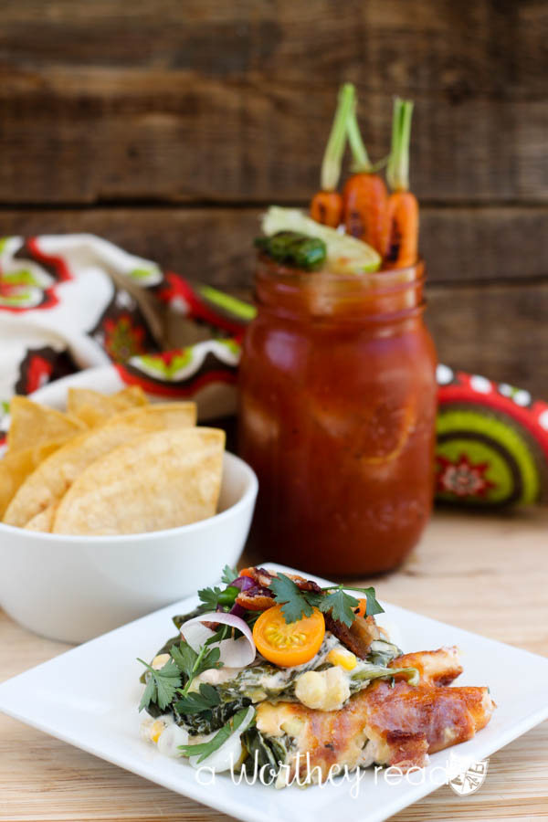 Hot Spinach & Sweet Corn Dip with Bacon Mini Salad & The Bloody Mary With Roasted Carrots & Pepper Cocktail. This combination packs a powerful punch of hot sauces, but not too hot. Dripping with cheesy goodness and dotted with fresh cut sweet corn off the cob, this easy appetizer is perfect for a game day appetizer or the upcoming holidays!
