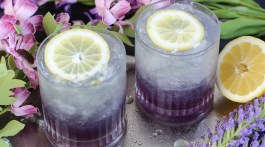 When it comes to libations that go well with the hot weather of summertime it is best to make sure those refreshments are slightly sweet, a whole lot of ice cold, and certifiably alcoholic!Our Limoncello + Lavender Frosted Cocktail is lemony plus lavender frosted dream come true! It takes like a spiked lavender lemonade. Bottoms up! Limoncello + Lavender Frosted Cocktail