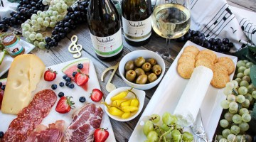 Cheese Boards are a great appetizer to serve at any party. It's important to pair your cheese board with a good wine, and we're sharing details on how to select a good wine to go along with your cheese board idea. Read below for all the notable details!
