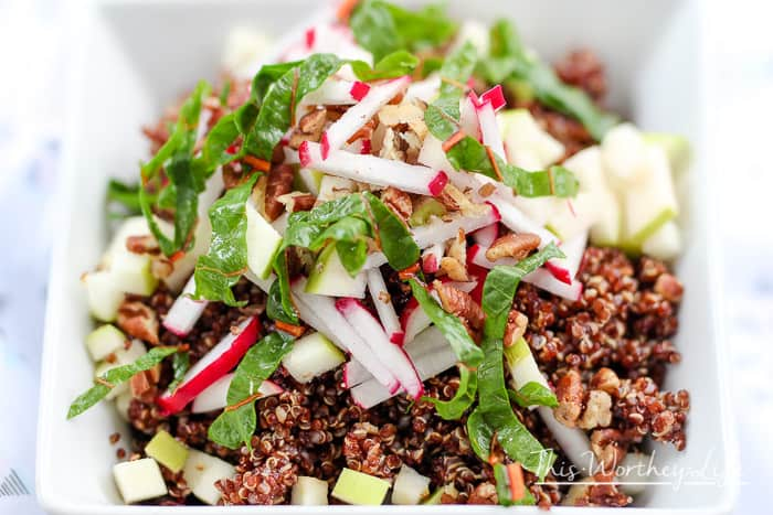 A farmer's market salad mixed with fresh veggies, red quinoa made in the instant pot, with cranberries and walnuts. Try our Red QuinoaSalad, a healthy salad recipe to enjoy any time of the year.