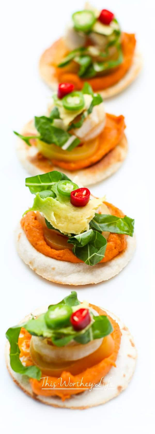 Get ready for game day with our fun appetizer using Sabra's Taco Inspired Hummus, plus chicken, fresh vegetables, laid on a flour tortilla. This easy appetizer will also be great toserve over the holidays, including Christmas appetizers, and a New Year's Eve party. Plus, when you're getting ready for the Superbowl, this chicken and hummus appetizer will be a crowd favorite!