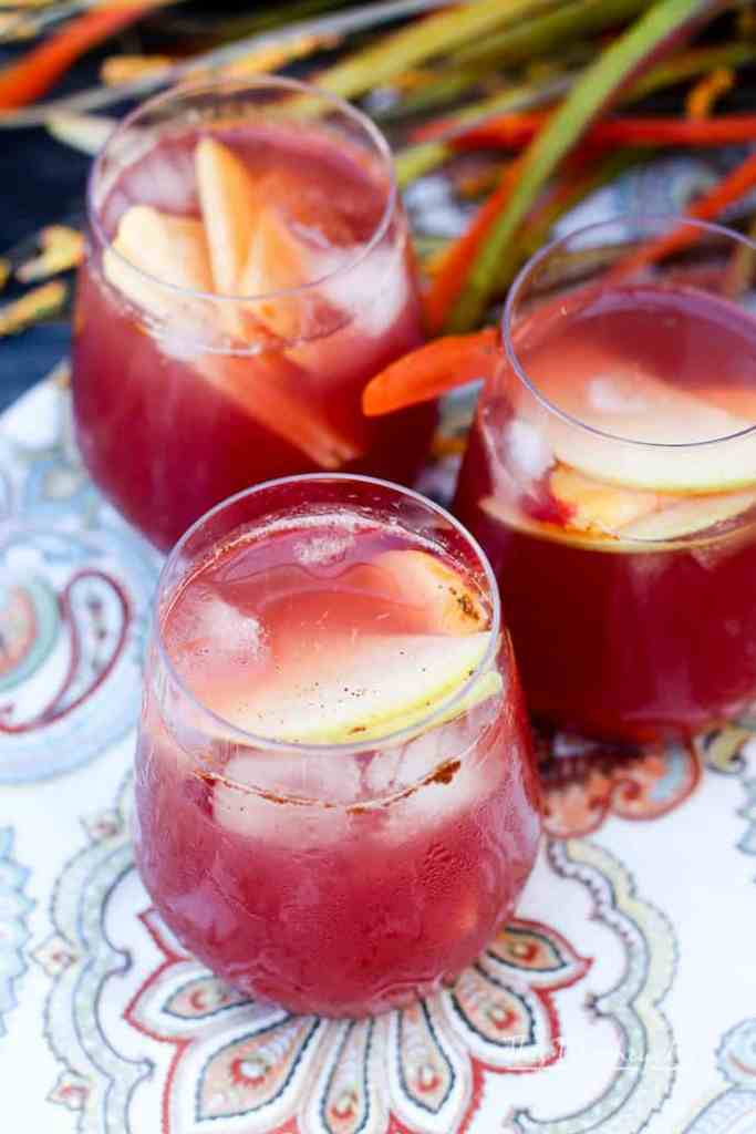 Mix up a batch of our Fall Fruit Sangria and enjoy so many of autumn's favorite fall flavors. It's mixed with slices of sweet apples, ripe plums, peaches, and a mix of slightly bubbly Rosé and delicious apple cider. The whole thing is sweetened with our homemade Blueberry + Cranberry Simple Syrup.