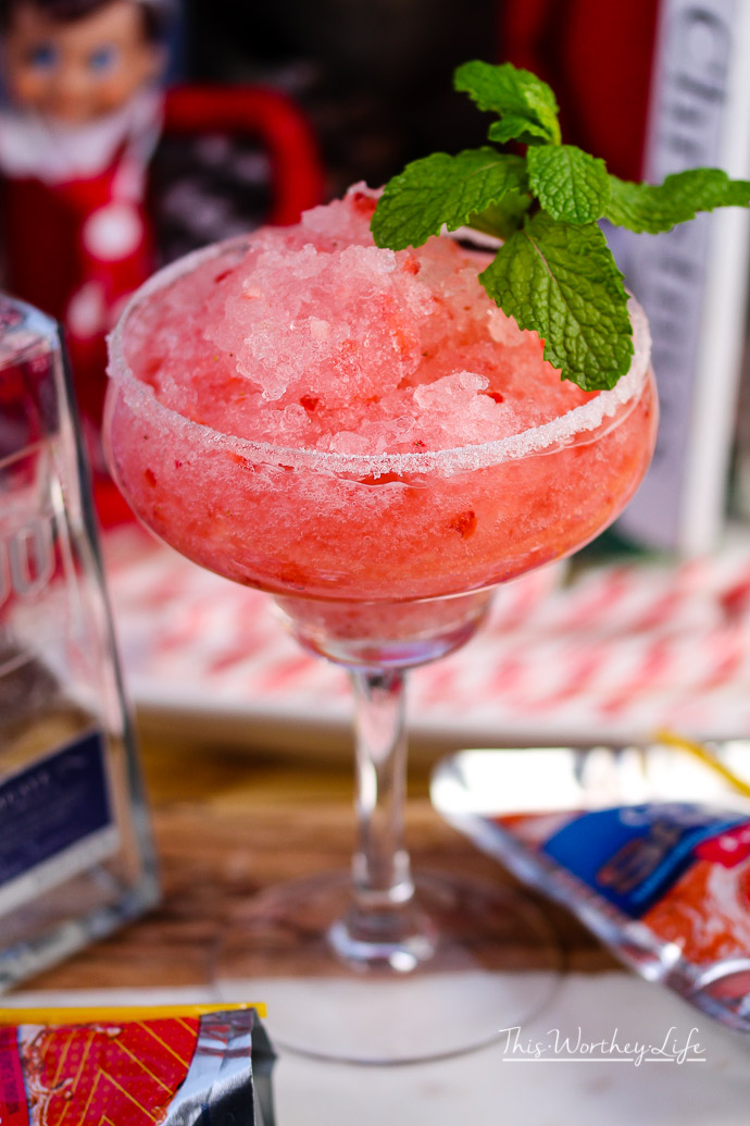 Get ready for National Margarita day with this Frozen Strawberry Margarita. This margarita is also great for summer parties, girl's night out, or anytime a margarita is needed!