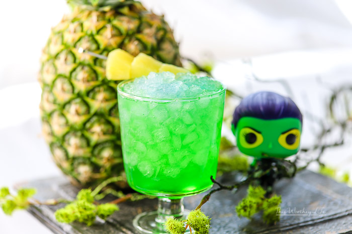 This fun kid-friendly green drink has pineapple juice, green apple syrup, and lemon-lime soda to make a Guardians of the Galaxy drink featuring Gamora! Check out how to make this fun green pineapple mocktail on our recipe blog.