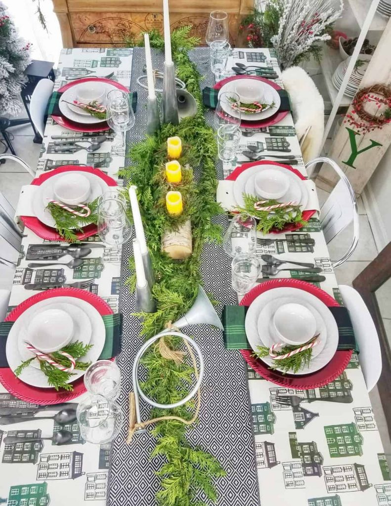 Are you a fan of HGTV's Fixer Upper couple, Chip & Jo? If so, you will love our Green + Black + Red Magnolia Themed Tablescape for the holidays. This table decor idea is inspired by their Hearth & Hand Magnolia Houseware line. Grab the details on the blog!