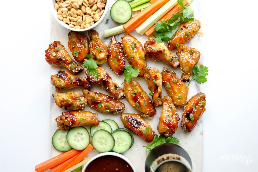 chicken wings on a white background with carrots