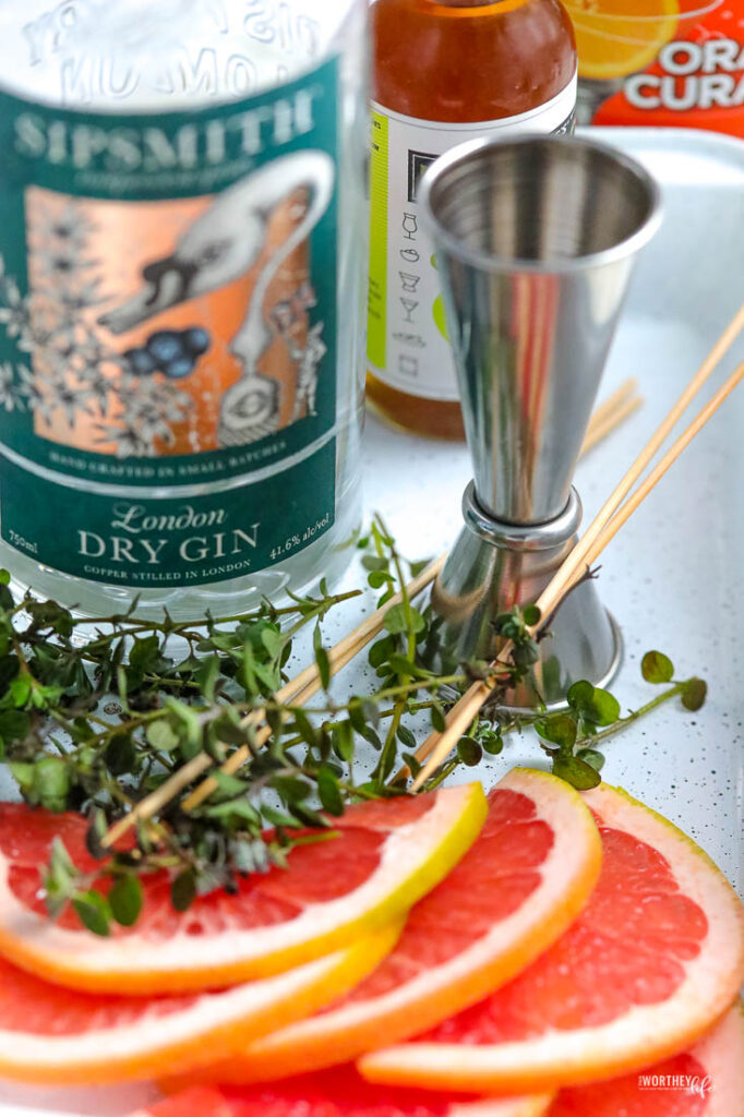 fresh grapefruit with a bottle of gin