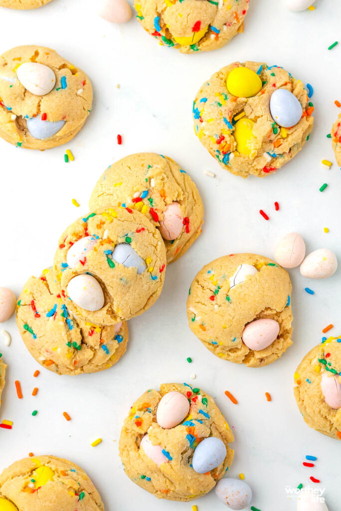 mini egg cookies spread out on a white background