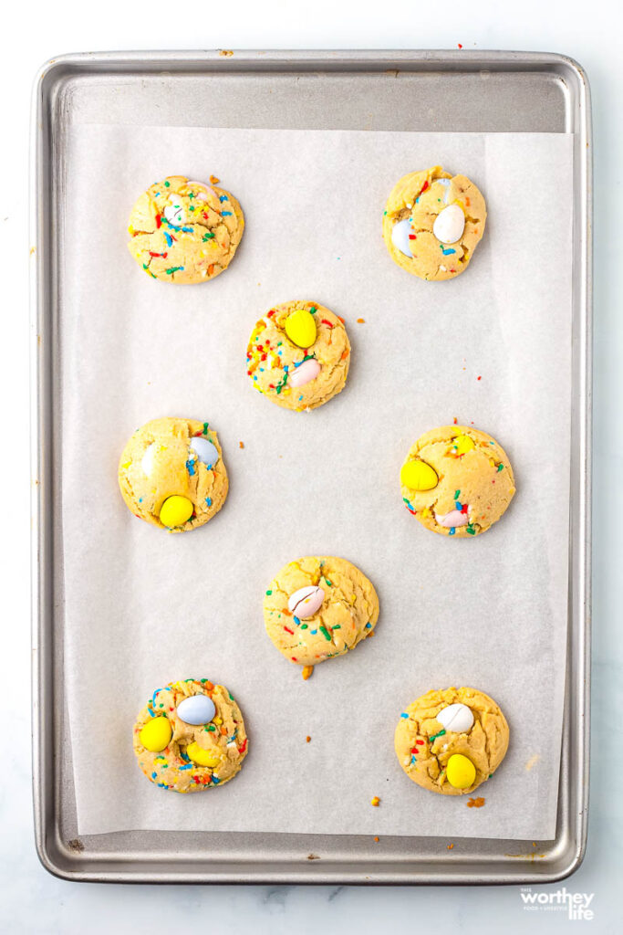 Cadbury Mini Egg Cookies on a baking sheet with parchment paper