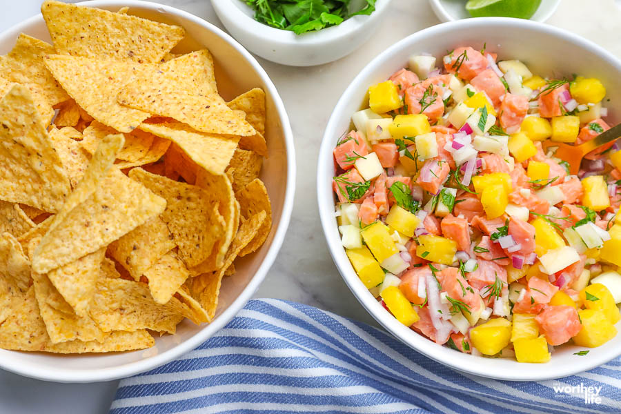 pineapple ceviche in a white bowl with corn chips
