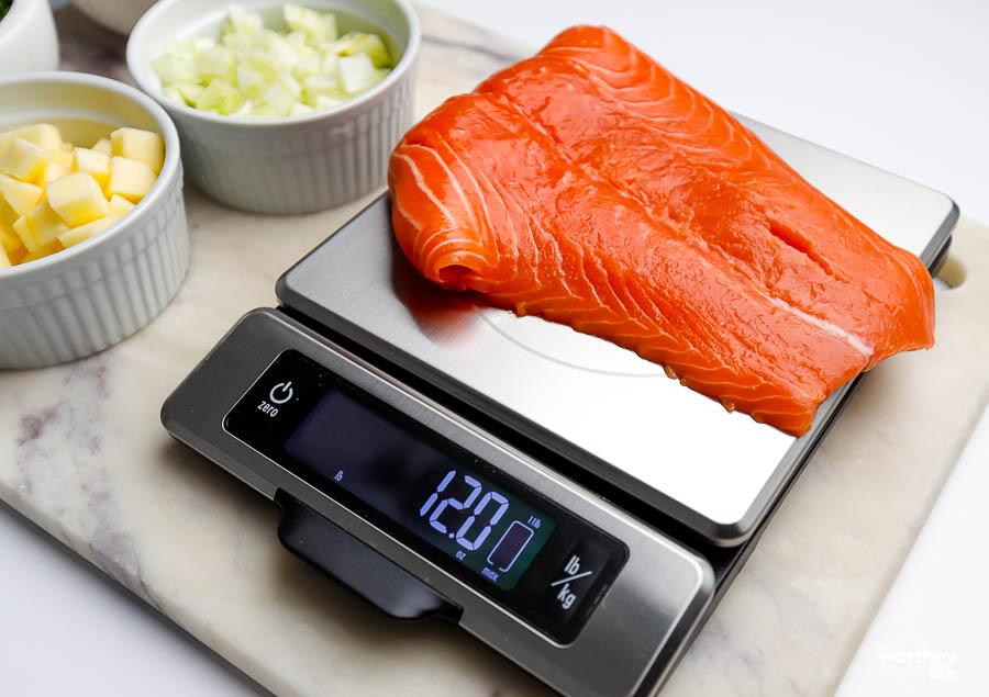 fresh salmon on food scale