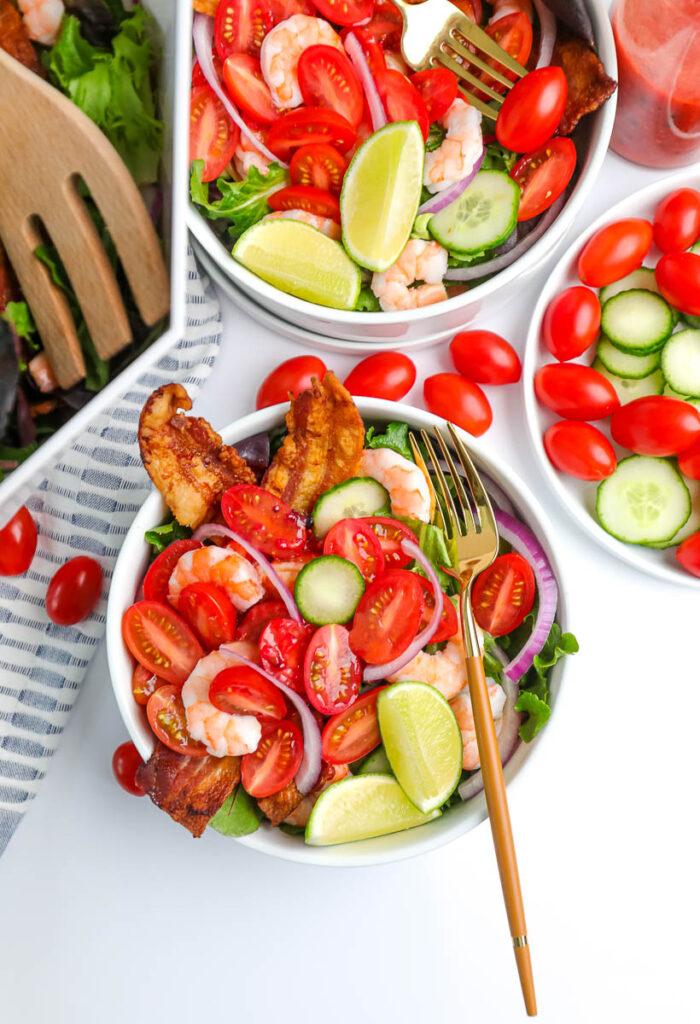 summer salads in white bowls
