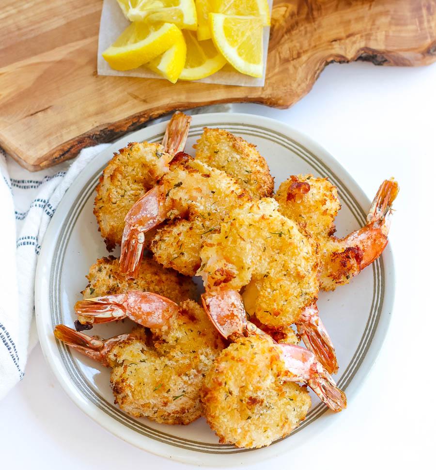 air fryer fried shrimp on a white platter