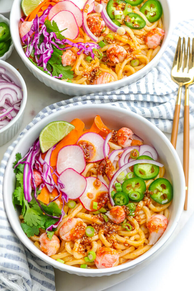 two white bowls of seafood soba noodle salad