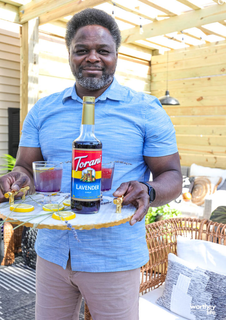 a man holding a serving tray