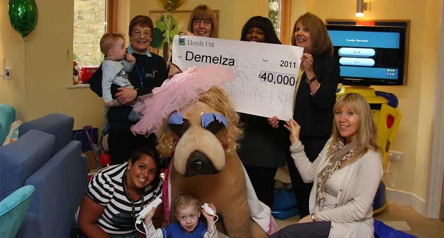 Axis Foundation trustee present £40,000 cheque to Demelza