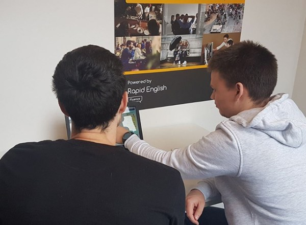 Young Man at the Fluence Foundation being helped with his communication skills