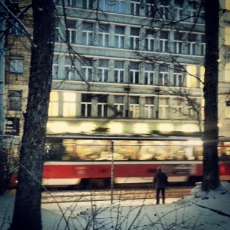 Tram at Karlovo square with snow in Prague