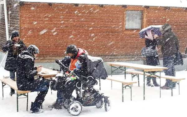 Naplavka in winter - people eating at farmers markets in snow
