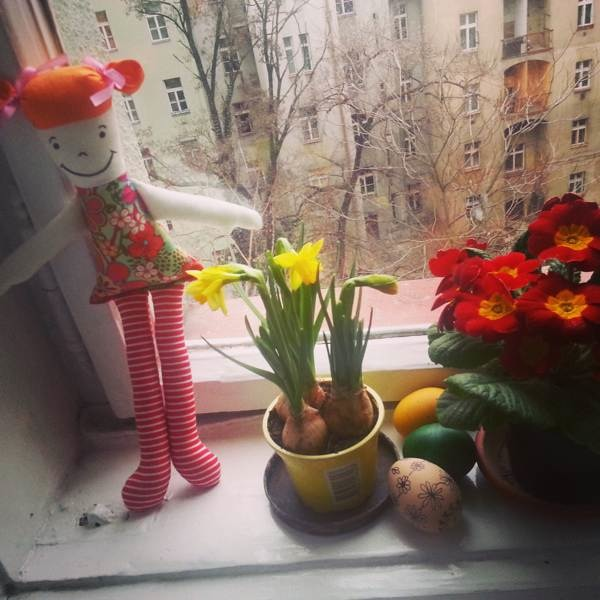 Hand made doll and daffodils on my windowsill