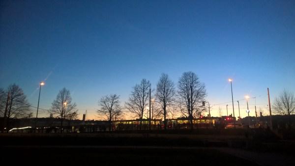 Horizon- blue night sky with a tram
