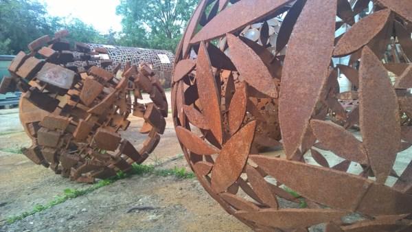 Art Studio Bubec Sculptures by Cestmir Suska Metal balls with patterns in the garden