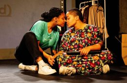 Sophia O'Donoghue and Jennifer Dixon are sitting on the floor, during the production of Willow. They are about to kiss