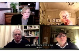 An image of a video call between four people.
