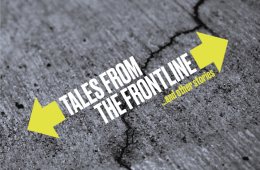 Text: Tales From the Front Line...and other stories, on a background of grey cracked paving stone