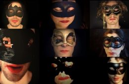A close of of eight people all wearing masks.