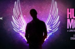 The silhouette of a person with neon purple wings.