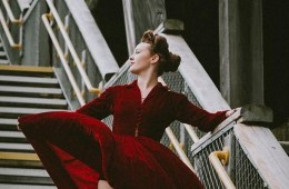 A woman in a red dress on a stair