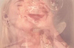 A blurry picture of showing the images of two women, their faces overlaying each other. The picture is faded and it is unclear what their expressions show.