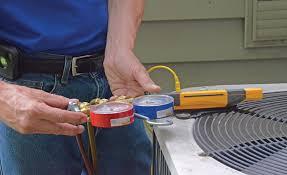 man installing AC