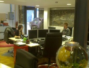 View of the Existem offices. Foreground: famous goldfish bowl. Background: Chris and Louisa