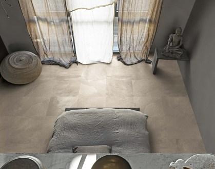 Pavimento de efecto piedra natural en el dormitorio