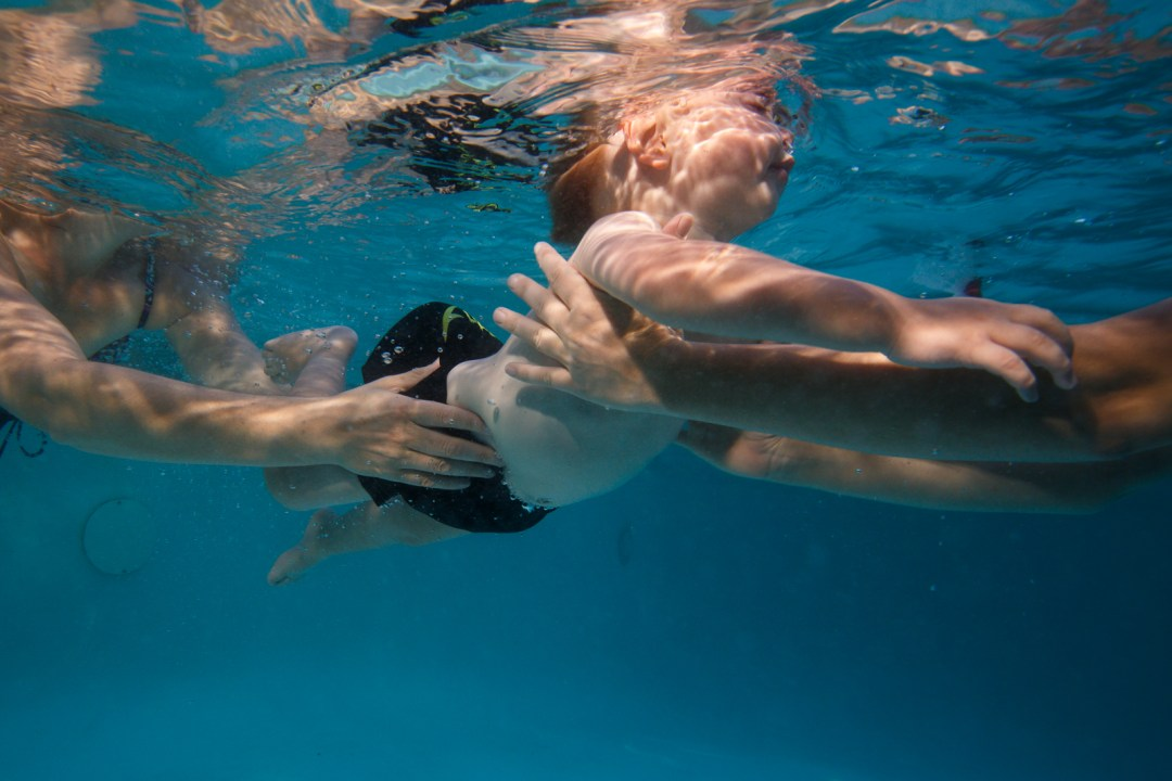 """No fear Dash. My youngest after spring swim lessons. He is a water baby through and through. Shown here practicing a """"handoff""""."""