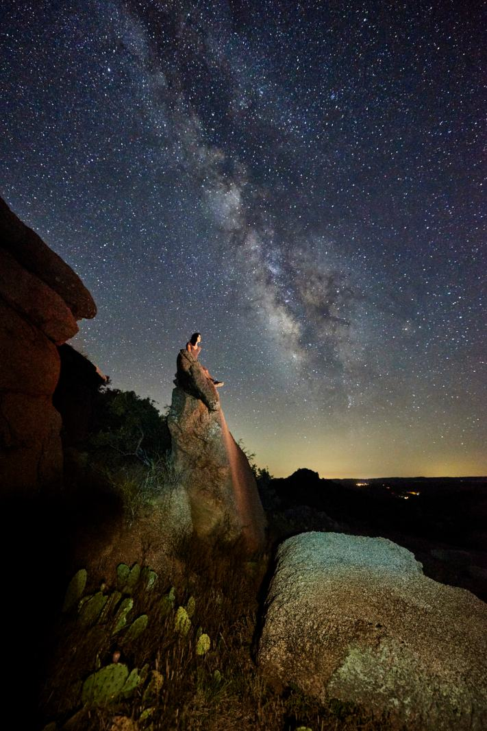 Milky way photo at Enchanted Rock in Texas with a 14mm lens in portrait orientation.