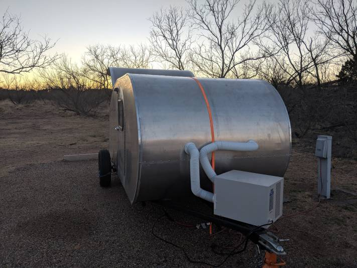 Home built Teardrop camper at sunset in Caprock Canyon State Park in North Texas.