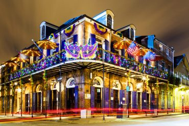 New Orleans, Louisiana USA- Jan 23 2016: Pubs and Bars having colorful lights and decorations in the French Quarter. Tourism provides a much needed financial source, also home for great many musicians.