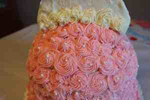closeup of edible glitter on pink and white cake