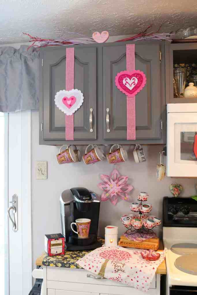 kitchen coffee station with felt hearts decorating the cabinets